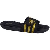 kengät Miehet Rantasandaalit adidas Originals Adissage Mustat,Kullanväriset