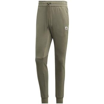 vaatteet Miehet Verryttelyhousut adidas Originals Brilliant Basics Vihreät