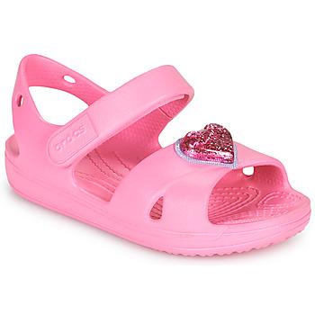 kengät Tytöt Sandaalit ja avokkaat Crocs CLASSICCROSSSTRAPCHARMSANDAL T Vaaleanpunainen