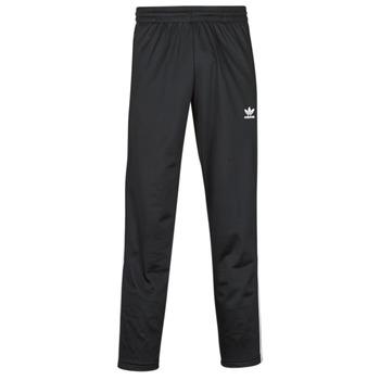 vaatteet Miehet Verryttelyhousut adidas Originals FIREBIRD TP Musta