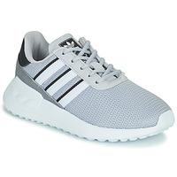 kengät Pojat Matalavartiset tennarit adidas Originals LA TRAINER LITE C Harmaa
